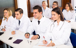 Multinational interns and professor having discussion Stock Image