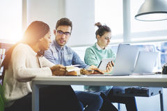 Multinational team of business school students searching information stock photo