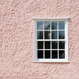 Multipanel window. In a pale pink wall Royalty Free Stock Image