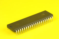 Multipin microchip. On yellow background Stock Photo