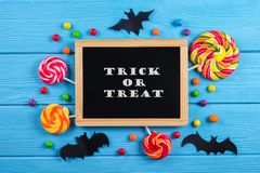 Multiple all hallows eve, treats for Halloween party on colorful background. royalty free stock photography