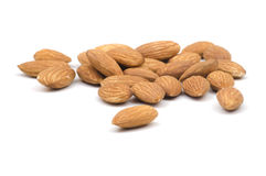 Multiple Almonds on White Background. Multiple almonds on a white background with the focus on the foreground almonde Stock Photo