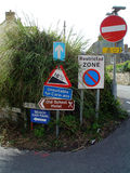Multiple assorted road signs in a row Stock Images