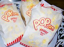 Multiple Bags of Buttered Pocorn stock images