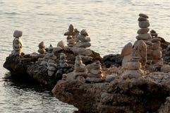 Multiple balanced stones. At the coast line of Croatia, Promajna area Royalty Free Stock Photos