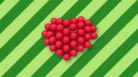 Multiple balloons forming a heart in the center on background with green stripes. Multiple red balloons forming a heart and slightly swaying in the air, placed stock video footage