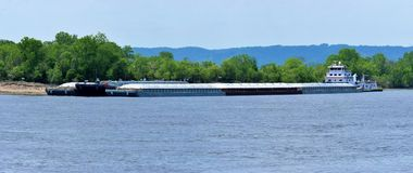Multiple barges being transported on the mississippi river royalty free stock photos