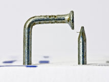 Multiple bent silvery nail. On white background Royalty Free Stock Images