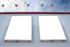 Multiple blank billboard with lamps Stock Image