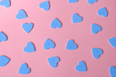 Multiple blue heart shapes as pink background Valentine's Day. Royalty Free Stock Image