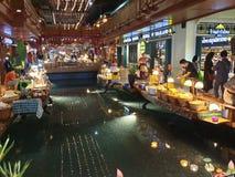 Multiple boat food stolls indoor water market stock photo