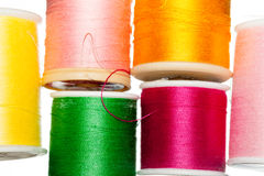 Multiple bobbins of cotton thread Stock Photos