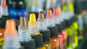 Multiple bottles with colorful inks for tattoo. Side view. Close-up Royalty Free Stock Image