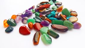 Multiple bright coloured semi precious gemstones and gems for decoration stock images