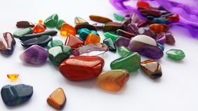 Multiple bright coloured semi precious gemstones and gems for decoration royalty free stock photo