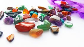 Multiple bright coloured semi precious gemstones and gems royalty free stock photos