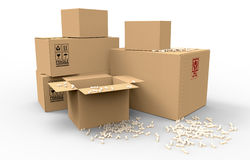 Multiple brown cardboard packing boxes. In a variety of sizes stacked on on top of the other in a pile for storage, packaging for mail or removals Royalty Free Stock Image