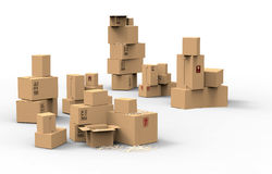 Multiple brown cardboard packing boxes. In a variety of sizes stacked on on top of the other in a pile for storage, packaging for mail or removals Stock Images