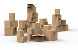 Multiple brown cardboard packing boxes. In a variety of sizes stacked on on top of the other in a pile for storage, packaging for mail or removals Royalty Free Stock Photos