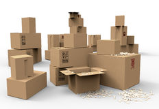 Multiple brown cardboard packing boxes. In a variety of sizes stacked on on top of the other in a pile for storage, packaging for mail or removals Stock Photo