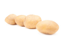 Multiple brown potatoes composition Stock Images