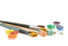 Multiple brushes next to a paint cases Royalty Free Stock Images