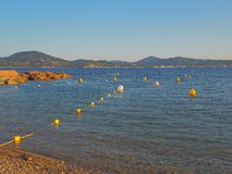 Multiple buoys in the water. stock photo