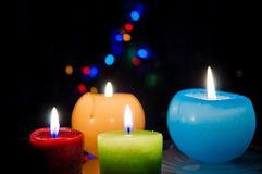Multiple burning candles. With bokeh lights in background Royalty Free Stock Image