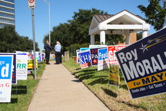 Multiple campaign signs with voters. Campaign signs at early voting location in Houston Texas (Tracy Gee Community Center). Early voting in Houston lasts until Royalty Free Stock Photos