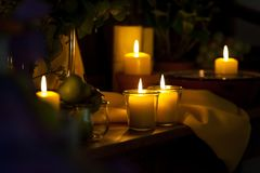 Multiple candles arrangement in dark room stock photo