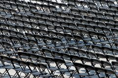 Multiple chairs outdoor, many black chair backs stock photo