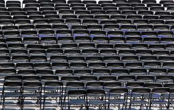 Multiple chairs outdoor, many black chair backs royalty free stock photography