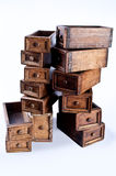 Multiple chest drawers stacked one above another. Small set of chest or chiffonier or wardrobe wood antique drawers used for clothes, cash, jewels, socks Stock Photo