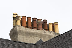 Multiple chimneys on St. John's row house roof Stock Photos