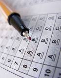 Multiple choice test. Answer sheet used for testing, multiple choice type, red fine line marker stock image