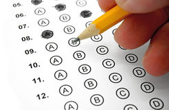 Multiple Choice Test. Filling out Answers on a Multiple Choice Test with a Yellow Pencil - Close Up View Royalty Free Stock Photos