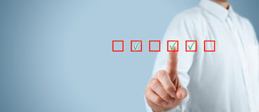 Multiple choices. Concept. Businessman click on multiple checkboxes Royalty Free Stock Image