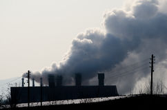 Multiple coal fossil fuel power plant smokestacks emit carbon dioxide pollution. Royalty Free Stock Photos