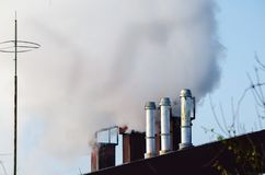 Multiple coal fossil fuel power plant smokestacks emit carbon dioxide pollution of environment and air Stock Images