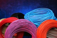 Multiple color cables. Texured background whith a blue light Stock Photo