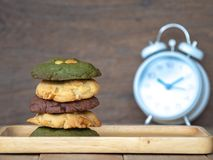 Multiple color cookies inclusive peanut butter, green tea cookies, and Chocolate Chip Cookies. Overlaid by alternating colors onMu. Multiple color cookies royalty free stock photography