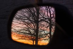 Sunrise in the Side Mirror Stock Image