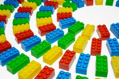 Multiple color toy blocks on white background. Angle view of colorful toy blocks on white background Stock Photo