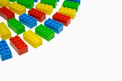 Multiple color toy blocks on white background. Perspective view of colorful toy blocks on white background. Copy space Stock Image