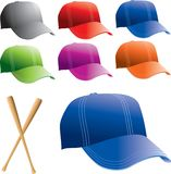 Multiple colored baseball hats. Assorted baseball hats and bats Stock Images