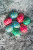 Multiple colored Easter eggs on fur, pink, blue and green eggs, easter backgroung stock images