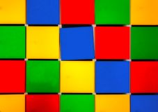Colored squares. Alignment of colored cubic squares stock image
