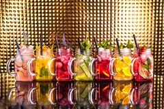 Multiple colorful cocktail lemonade with fresh fruits royalty free stock image