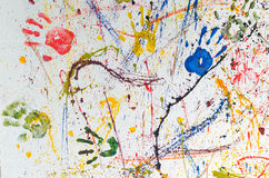 Multiple colorful hand prints. Multiple colorful children hand prints on white wall stock photography