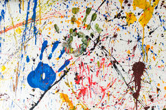 Multiple colorful hand prints. Multiple colorful children hand prints on white wall royalty free stock photography